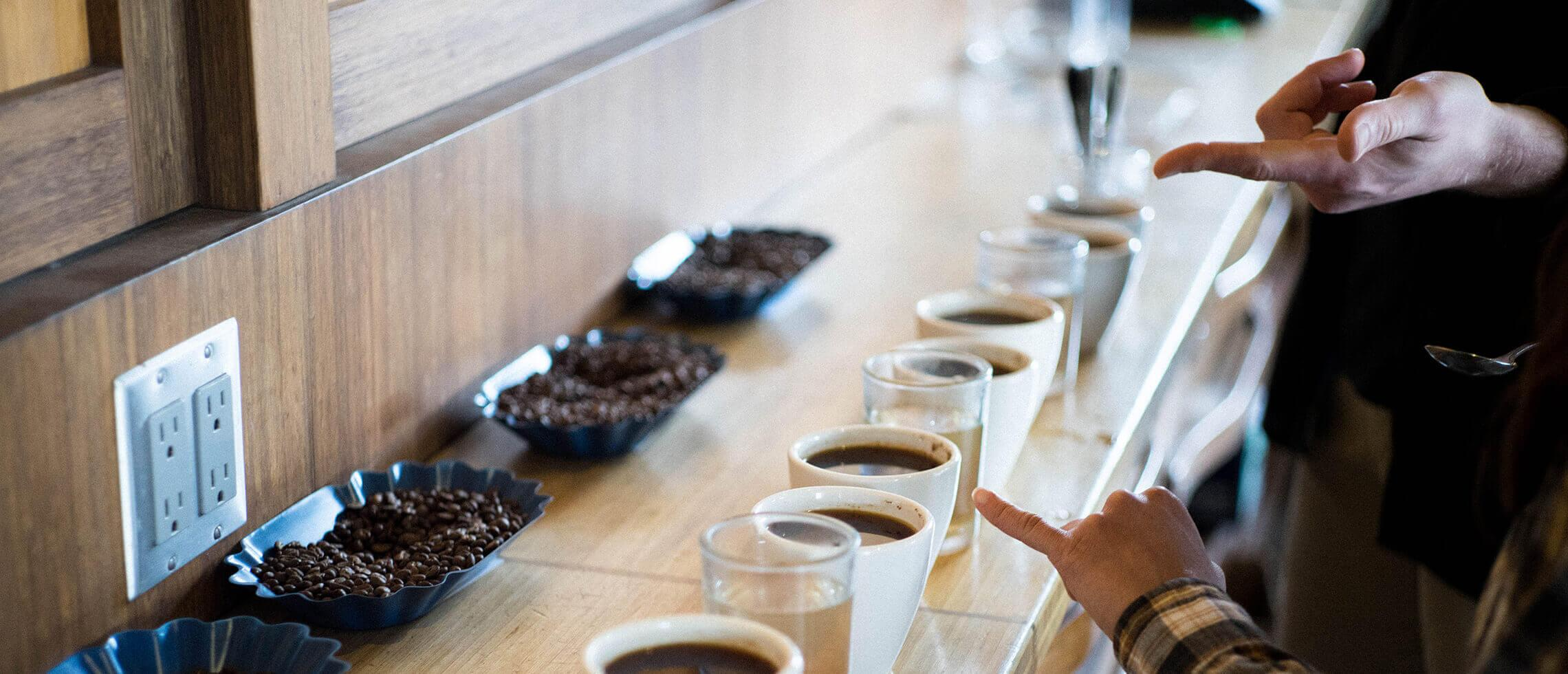 Cupping coffee at Coava Grand